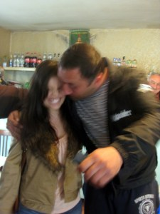 """Jenni had the """"best"""" luck of all!  Here she is being almost-kissed by the German-speaking dude who was convinced she was from Nigeria and would become his African Queen/Kitchen Wife.  It was a happy day for Jenni!"""