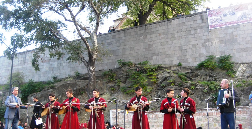 This group of teenagers had a pair of teachers with them on the flanks of the group.  Here you can see the boys on the left playing the Chonduri, then center boys playing Panduris, and a pair of flutists on the right, before the accordion.